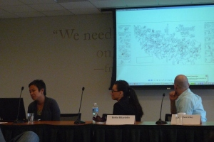 The panelists lecturing
